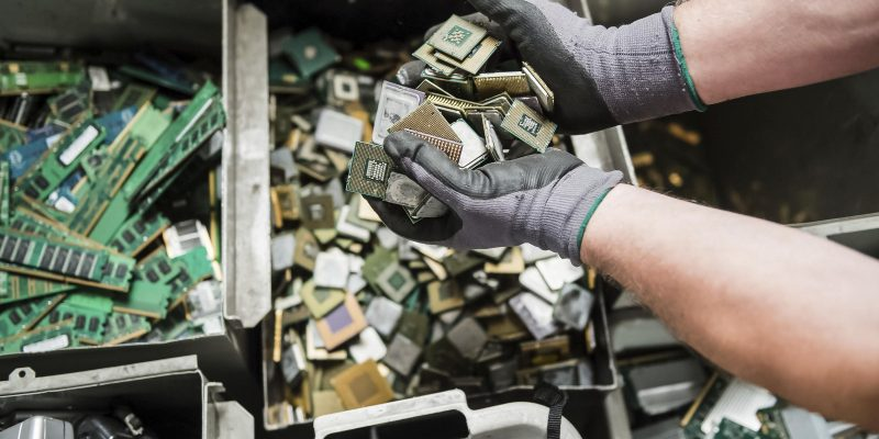 In this photo taken on July 13, 2018, a worker handles components of electronic elements at the Out Of Use company warehouse in Beringen, Belgium. Out Of Use dismantles computer, office and other equipment and recuperates an average of around 90 percent of the raw materials from electronic waste. (AP Photo/Geert Vanden Wijngaert)